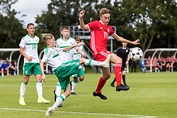 WREXHAM, WALES - Thursday, August 15, 2019: Wales' Alex Roberts and Northern Ireland's Thomas Connolly during the UEFA Under-15's Development Tournament match between Wales and Northern Ireland at Colliers Park. (Pic by Paul Greenwood/Propaganda)