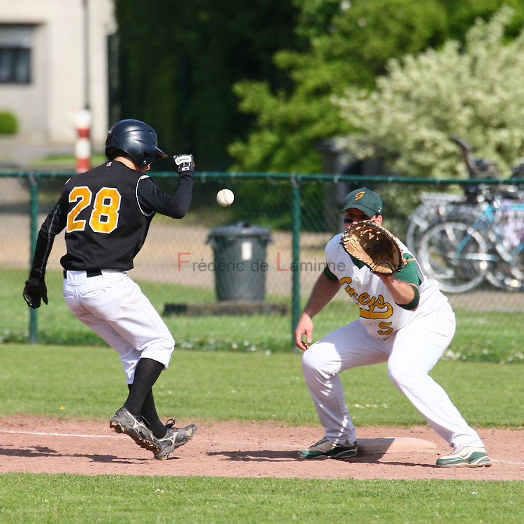 May 22, 2010; Merksem, Belgium. Belgian Baseball Championship (1BB) : match between the Merksem Greys  and the Namur Angels (black). Namur Angels Florentin Goyens (28) moves back to 1st base in a pickoff attempt by the Greys. Greys defeated the Angels 3-1.