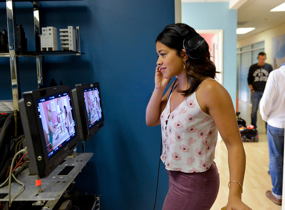"""Jane The Virgin -- """"Chapter Seventy-Four"""" -- Image Number: JAV410c_0023.jpg -- Pictured: Director Gina Rodriguez -- Photo: Lisa Rose/The CW -- © 2018 The CW Network, LLC. All Rights Reserved."""