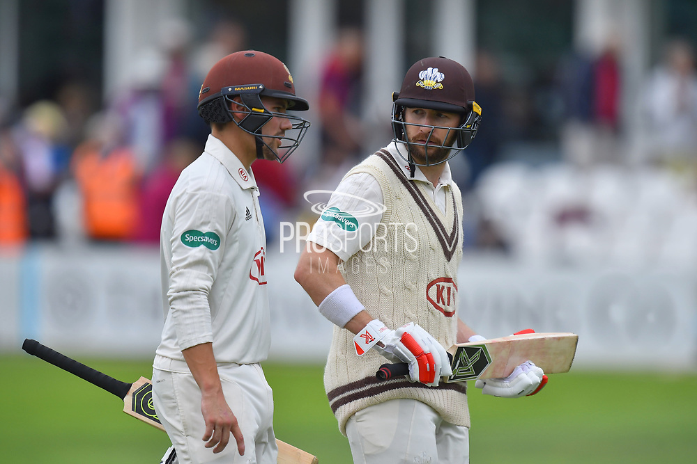 Rory Burns of Surrey and Mark Stoneman of Surrey walk off for lunch during the opening day of the Specsavers County Champ Div 1 match between Somerset County Cricket Club and Surrey County Cricket Club at the Cooper Associates County Ground, Taunton, United Kingdom on 18 September 2018.