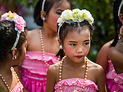 11 AUGUST 2016 - BANGKOK, THAILAND: School girls wait to perform in a Mothers' Day event on the grounds of Wat Pho in Bangkok. Wat Pho (the Temple of the Reclining Buddha), is formally known as Wat Phra Chetuphon. It's one of the largest temple complexes in Bangkok and best known for the giant reclining Buddha that measures 46 metres long and is covered in gold leaf. There is also a large ordination hall and the best known massage school in Thailand on the temple grounds.         PHOTO BY JACK KURTZ