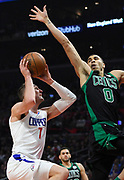 LA Clippers forward Sam Dekker #7 goes up for a shot against LA Clippers guard Sindarius Thornwell #0 in the first half. The Los Angeles Clippers played the Boston Celtics in a regular season NBA matchup in Los Angeles, CA 1/025/2018 (Photo by John McCoy, Los Angeles Daily News/SCNG)