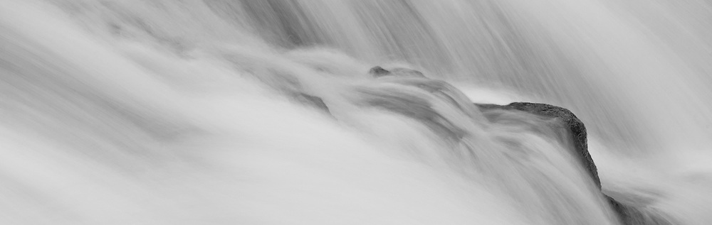 Photograph of a section of a waterfall at Buttermilk Falls in the Adirondacks, representing the perseverence of rock against the tiemless forces of nature.  This print is in the permanent collection of the VIEW Gallery/Art Museum in Old Forge, NY.