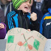 Micheál De Bruin cheering on the Kilnamona Hurling team