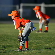 Young baseball players waiting for a play in the outfield during the Norwalk Little League baseball competition at Broad River Fields,  Norwalk, Connecticut. USA. Photo Tim Clayton