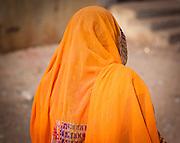 Indian woman in orange sari (India)