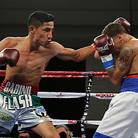 KISSIMMEE, FL - MARCH 06:  Gabino Cota (L) punches Jonathan Oquendo as they fight for the WBO Latino Flyweight Title during the Telemundo Boxeo boxing match at the Kissimmee Civic Center on March 6, 2015 in Kissimmee, Florida. Oquendo won the belt after a 10 round unanimous decision on the scorecards. (Photo by Alex Menendez/Getty Images) *** Local Caption *** Jonathan Oquendo; Gabino Cota