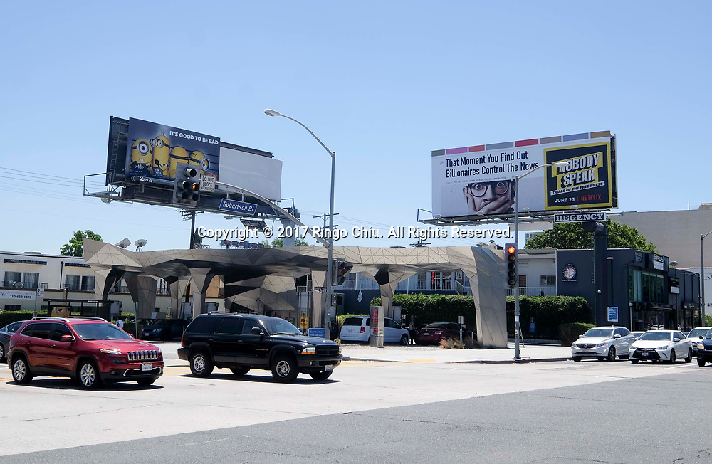Digital billboards at ARCO station on southeast corner of Olympic Boulevard and Robertson Boulevard in Los Angeles.