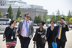 April 30, 2019 - Washington, District of Columbia, U.S. - United States Representative Ilhan Omar, Democrat of Minnesota, walks with staff to a press event in front of the United States Capitol in Washington, D.C. on April 30, 2019. Several members of Congress attended the event and spoke out against recent tweets by President Donald Trump that attacked Rep. Omar. Credit: Alex Edelman / CNP (Credit Image: © Alex Edelman/CNP via ZUMA Wire)