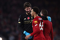 Football - 2019 / 2020 Premier League - Liverpool vs. Manchester City<br /> <br /> Liverpool goalkeeper Alisson Becker with Trent Alexander-Arnold at the end of the match, at Anfield.<br /> <br /> COLORSPORT/PAUL GREENWOOD
