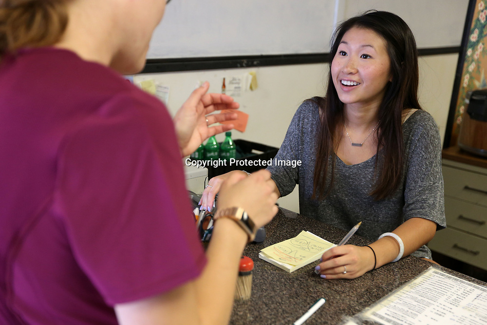 Michelle Chow talks with customer Deanna Miller, of Blue Springs, as she takes her walk in order at the counter.