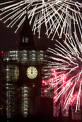 © Licensed to London News Pictures. 01/01/2018. London, UK. Fireworks over Parliament and Big Ben herald the start of the New Year 2018. Photo credit: Peter Macdiarmid/LNP