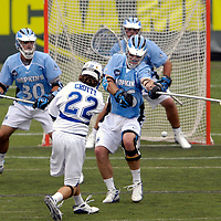28 May 2007:  Duke University mid fielder Ned Crotty (22) shoots and scores in the 2nd quarter against Johns Hopkins defenseman Eric Zerrlaut (16) in the NCAA Division I Lacrosse Championship game.  The Johns Hopkins Blue Jays defeated the Duke Blue Devils 12-11 to win the NCAA Division I Lacrosse championship at M&T Bank Stadium in Baltimore, Md. .