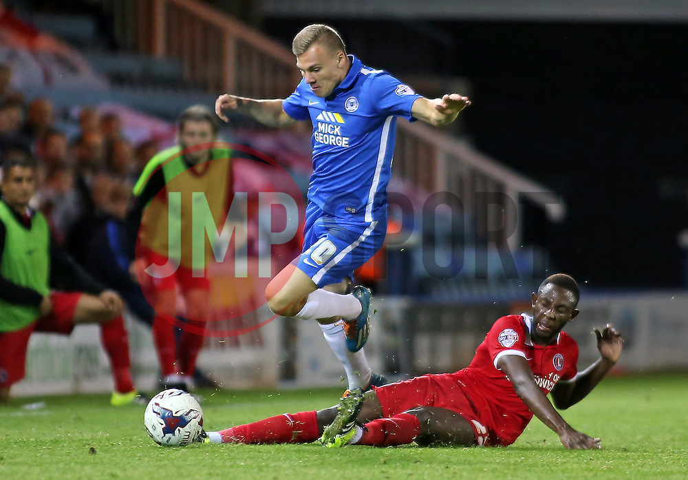 Harry Anderson of Peterborough United is tackled by El-Hajdi Ba of Charlton Athletic - Mandatory byline: Joe Dent/JMP - 07966386802 - 25/08/2015 - FOOTBALL - ABAX Stadium -Peterborough,England - Peterborough United v Charlton Athletic - Capital One Cup - Second Round
