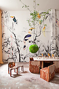Pablo Piatti 'Tropical Birds' wallpaper mural (Tres Tintas Barcelona), Max Lamb (Johnson Trading Gallery) chair and stool,  Alex Gil (Spacecutter) 'Monolith' dining table, Ovando: Floral Design and Event Production Hanging Trees, ceramics by Melissa Gamwell and Natalia Criado
