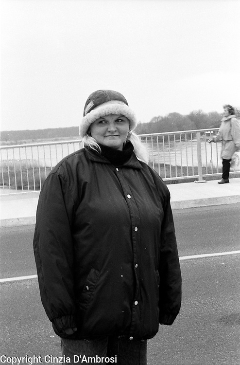 Stubice border city to Frankfurt Oder. A Polish woman begging on the Polish side over the bridge confining the two countries. Stubice, Poland.