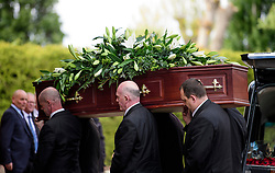 © Licensed to London News Pictures. 05/05/2017. London, UK. The coffin entering the crematorium. The funeral of Westminster Terror attack victim Leslie Rhodes takes place at North East Surrey Crematorium in Morden, South London. Leslie Rhodes, who was Winston Churchill's former window cleaner, suffered serious injuries when terrorist Khalid Masood mowed down and killed 4 pedestrians on Westminster Bridge before attacking and killing a police officer with a knife.  Photo credit: Ben Cawthra/LNP