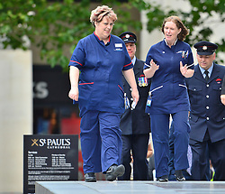 © Licensed to London News Pictures. 07/07/2015. London, UK. A group of Nurses arriving at the service. . A church service held at St Paul's Cathedral In London on the 10th anniversary of the 7/7 bombings in London which killed 52 civilians and injured over 700 more.  Photo credit: Ben Cawthra/LNP