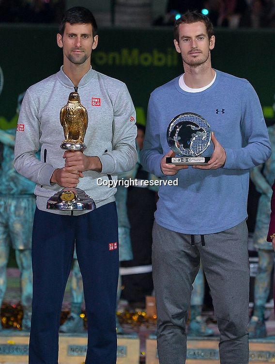 07.01.2017. Doha, Qatar. Novak Djokovic (L) of Serbia and Andy Murray of Britain pose after the awards ceremony for the men's singles event of the Qatar ATP Tennis Herren Open tennis tournament at the Khalifa International Tennis Complex in Doha.