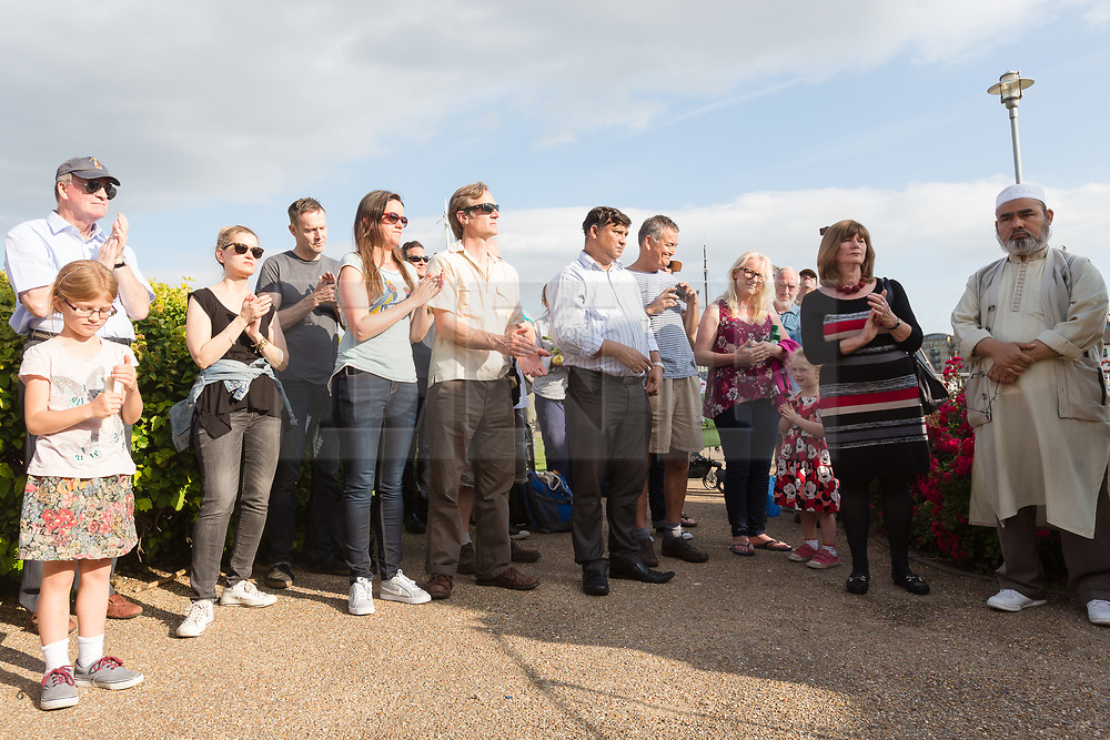 © Licensed to London News Pictures. 16/06/2017. LONDON, UK.  Neighbours and friends of Jo Cox attend The Great Get Together near Hermitage Moorings in Wapping to pay tribute and celebrate Jo's call that more unites us than divides us on the anniversary of her death. Jo Cox lived on a house boat in Wapping with her husband Brendan Cox and two children. Photo credit: Vickie Flores/LNP