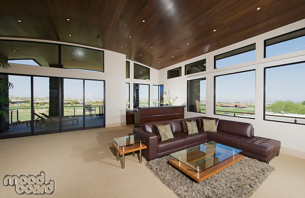 Interior with furniture and large windows with outside views