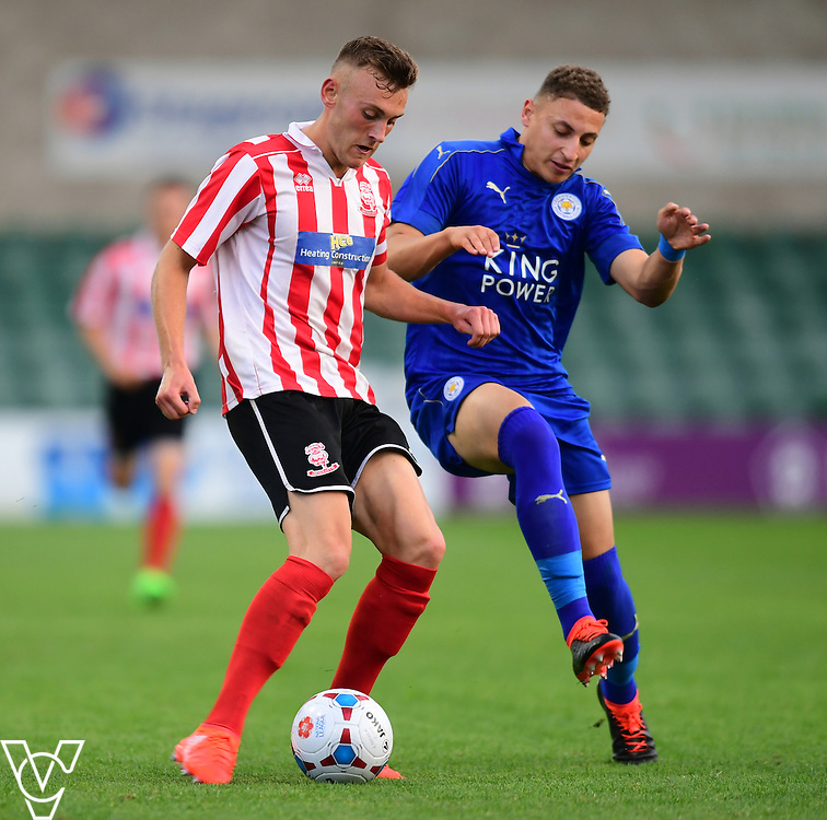 Lincoln City&rsquo;s Jack Fixter vies for possession with Leicester City&rsquo;s Calvin Bassey<br /> <br /> Lincoln City under 18s Vs Leicester City under 18s at Sincil Bank, Lincoln.<br /> <br /> Picture: Chris Vaughan/Chris Vaughan Photography<br /> <br /> Date: July 28, 2016