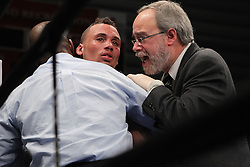 Mar 24; Brooklyn, NY, USA; Vernon Paris talks to doctors after getting knocked out in the 9th round of his bout against Zab Judah at the Aviator.