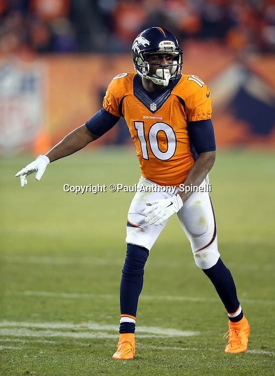 Denver Broncos wide receiver Emmanuel Sanders (10) points as he gets set to go out for a pass during the 2015 NFL week 16 regular season football game against the Cincinnati Bengals on Monday, Dec. 28, 2015 in Denver. The Broncos won the game in overtime 20-17. (©Paul Anthony Spinelli)