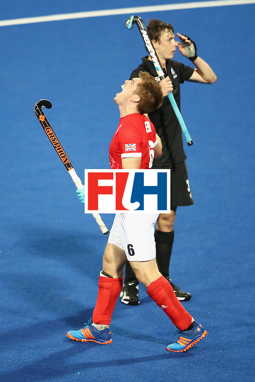 RIO DE JANEIRO, BRAZIL - AUGUST 07:  Henry Weir of Great Britain celebrates a Great Britain goal as Nick Wilson of New Zealand looks dejected during the men's pool A match between Great Britain and New Zealand on Day 2 of the Rio 2016 Olympic Games at the Olympic Hockey Centre on August 7, 2016 in Rio de Janeiro, Brazil.  (Photo by Mark Kolbe/Getty Images)