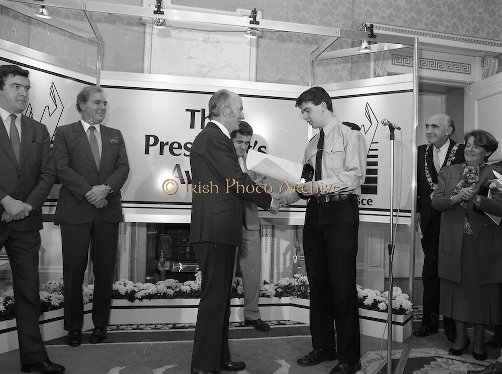 28/10/1985<br /> 10/28/1985<br /> 28 October 1985<br /> Launch of Gaisce The Presidents Award at Aras an Uachtarain. President Dr. Patrick Hillery launched the new national youth award scheme to be the nations highest award to Irish young people aged 15-25. Picture shows Donal Smyth (left) presenting his pledge to President Hillery. Mr John Murphy, Executive Director of the award in centre and Dr. Tony O'Reilly (2nd left) also feature in the image.