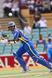 © Licensed to London News Pictures. 14/02/2012. Adelaide Oval, Australia. Sri Lankan batsman Dinesh Chandimal looks on as he is about to go for a run during the One Day International cricket match between India Vs Sri Lanka. Photo credit : Asanka Brendon Ratnayake/LNP