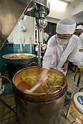 "Kantetsu Jahana operates a mixer that binds ingredients in the traditional ""kippan"" confectionery made from the kaabuchi citrus fruit at the Janaha Kippan-ten store in Naha, Okinawa, Japan on 27 June 2012. Today the Jahana family are the only people still making the traditional Kippan and Tougatsuke (which is made from ""tougan"" winter melons) sweets that were served at the court of the Ryukyu kings over 300 years ago. Photo: Robert Gilhooly."