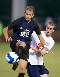 Old Dominion Monarchs midfielder Roberto Sgueglia (11) protects the ball from Virginia Cavaliers forward Brian Ownby (27).  The Virginia Cavaliers defeated the Old Dominion Monarchs 3-0 in a pre-season NCAA Men's Soccer exhibition game held at Klockner Stadium on the Grounds of the University of Virginia in Charlottesville, VA on August 23, 2008.