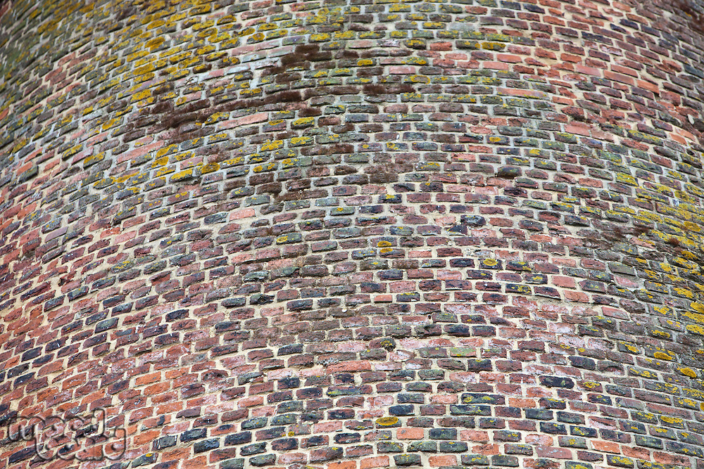 Close-up view of  red cobbled tower