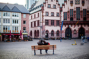 """Germany banned gatherings of more than 2 people called """"social distancing"""" because of the coronavirus. The empty city center called """"Römer"""" in Frankfurt am Main during a normally busy Thursday evening. Two men doing a selfie."""