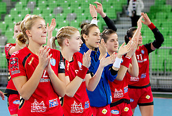 Sanja Gregorc, Tamara Mavsar, Iris Guberinic of Krim celebrate after winning the handball match between RK Krim Mercator (SLO) and RK Podravka Vegeta (CRO) in Women's EHF Champions League, on November 13, 2010 in Arena Stozice, Ljubljana, Slovenia. Krim defeated Podravka 26:22 and qualified to Main Round of Champions League. (Photo By Vid Ponikvar / Sportida.com)