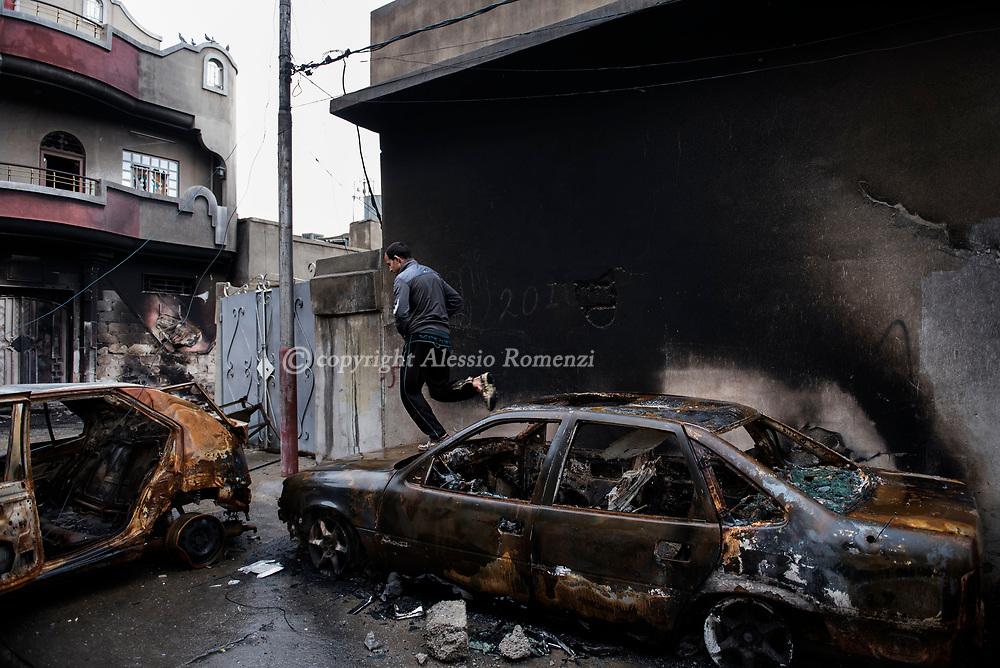 Iraq, Mosul: A Mosul resident inside the heavily damaged Wadi Ajar neighbourhood in west Mosul. Alessio Romenzi