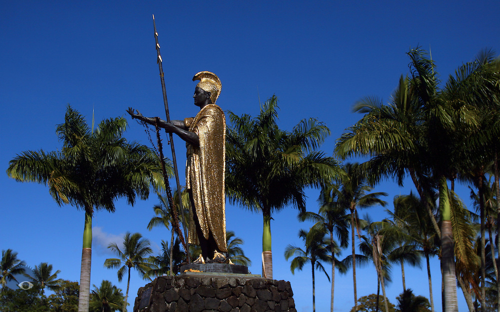 A King Kamehameha the Great statue towers above the land in Hilo on the Big Island, Hawaii.