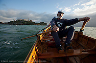 Ed DeCossio and Phil Kohlenberg rowing toward Alcatraz from the Dolphin Club in Aquatic Park, San Francisco