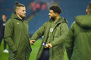 Kalvin Phillips of Leeds United (23) shares a joke with Tyler Roberts of Leeds United (11) after arriving at the ground during the EFL Sky Bet Championship match between Leeds United and West Bromwich Albion at Elland Road, Leeds, England on 1 March 2019.