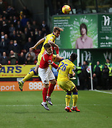 Leeds United defender and captain Liam Cooper winning a header with Chaltons first attack during the Sky Bet Championship match between Charlton Athletic and Leeds United at The Valley, London, England on 12 December 2015. Photo by Matthew Redman.
