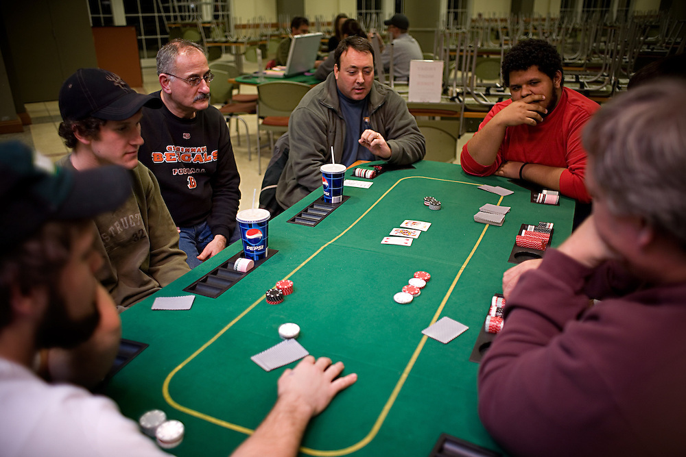 From left to right, Dan Ouellette, Travis Ouellette, Tim Chiki, Steve Chiki, Mark Sullivan, Jose' Gonza'lez and Sean Sullivan (hidden) play poker at Baker Center in Athens, Ohio on Friday, Jan. 25, 2008. ( /CHAD BARTLETT)