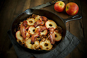 Photograph of fried apples, onions and bacon for the Little House Cookbook