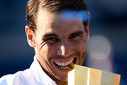 August 12, 2018 - Toronto, ON, U.S. - TORONTO, ON - AUGUST 12: Rafael Nadal (ESP) takes a bite of the championship trophy after winning the Rogers Cup tennis tournament Final on August 12, 2018, at Aviva Centre in Toronto, ON, Canada. (Photograph by Julian Avram/Icon Sportswire) (Credit Image: © Julian Avram/Icon SMI via ZUMA Press)