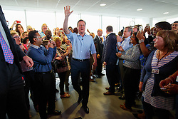 © Licensed to London News Pictures. 05/05/2015. LONDON, UK. Conservatives leader and Prime Minister David Cameron and Mayor of London Boris Johnson arriving to speak to staff at Utility Warehouse in Hendon, northwest London on Tuesday, 5 May 2015. Photo credit : Tolga Akmen/LNP