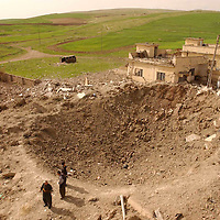 SHEKHAN (Ayn Sifni), NORTHERN IRAQ - April 9: The Bathist office in  Shekhan was missed by a huge bomb that has flattened 3 houses and left a enourmous crater. A town of about 30000 inhabitants on the way to Mossul has been taken by Peshmergas. Kurdish Peshmergas and US Special forces are advancing towards  Mossul.   (Photo Patrick Barth/Getty Images)