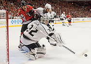 Kings' goaltender Jonathan Quick pokes the puck in front of teammate Willie Mitchell and the Blackhawks' Andrew Shaw during Chicago's 5-4 victory in Game 5 of the Western Conference Final of the 2014 NHL Stanley Cup Playoffs at United Center in Chicago Wednesday.