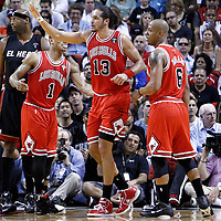 06 March 2011: Chicago Bulls point guard Derrick Rose (1), Chicago Bulls shooting guard Keith Bogans (6) and Chicago Bulls center Joakim Noah (13) are seen during the Chicago Bulls 87-86 victory over the Miami Heat at the AmericanAirlines Arena, Miami, Florida, USA.