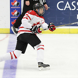 COBOURG, - Dec 19, 2015 -  Gold Metal Game - Russia vs Canada West at the 2015 World Junior A Challenge at the Cobourg Community Centre, ON. Dennis Cholowski #9 of Team Canada West shoots the puck during the second period.(Photo: Tim Bates / OJHL Images)