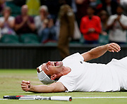 epaselect epa06090219 Lukasz Kubot of Poland and Marcelo Melo (unseen) of Brazil celebrate winning against Oliver Marach of Austria and Mate Pavic of Croatia during their Men's Doubles final match for the Wimbledon Championships at the All England Lawn Tennis Club, in London, Britain, 15 July 2017.  EPA/NIC BOTHMA EDITORIAL USE ONLY/NO COMMERCIAL SALES
